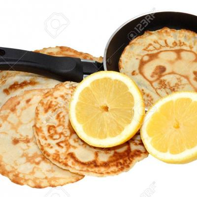 26571941-freshly-made-pancakes-with-lemon-and-frying-pan-traditionally-eaten-in-england-on-shrove-tuesday-als